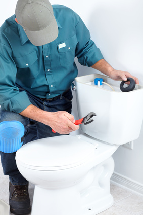 plumber-installing-or-replacing-old-toilet
